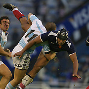 Thierry Dusautoir, France, is tackled by Lucas Gonzalez Amorosino, Argentina, during the Argentina V France test match at Estadio Jose Amalfitani, Buenos Aires,  Argentina. 26th June 2010. Photo Tim Clayton...