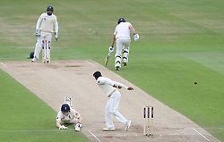 England's Dominic Bess dives for the crease as Pakistan's Shadab Khan attempts a run out during day two of the Second Natwest Test match at Headingley, Leeds.