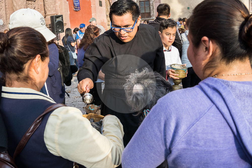 A Roman Catholic priest blesses a pet turtle during the annual blessing of the animals on the feast day of San Antonio Abad at Oratorio de San Felipe Neri church January 17, 2020 in the historic center of San Miguel de Allende, Guanajuato, Mexico.