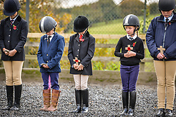 Young members of the RNRM Junior Saddle Club hold wooden crosses at the Royal Navy and Royal Marines Riding Stables at Bickleigh Barracks, Plymouth, during the first ever memorial service dedicated to horses killed or injured in conflict.