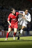 Photo: Aidan Ellis.<br /> Liverpool v Bolton Wanderers. The Barclays Premiership. 09/04/2006.<br /> liverpool's Luis Garcia battless with Bolton's Ricardo Gardener