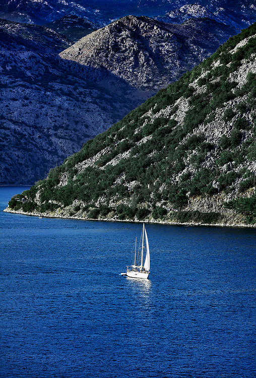 Sailboat exploring the scenic Bay of Kotor, Montenegro