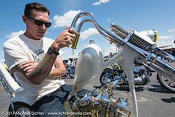 Hawk of Vintage technologies in Montana built this Shovelhead with backwards heads at the Rats Hole Show at the Buffalo Chips Crossroads area during the annual Sturgis Black Hills Motorcycle Rally.  SD, USA. Thursday August 10, 2017.  Photography ©2017 Michael Lichter.