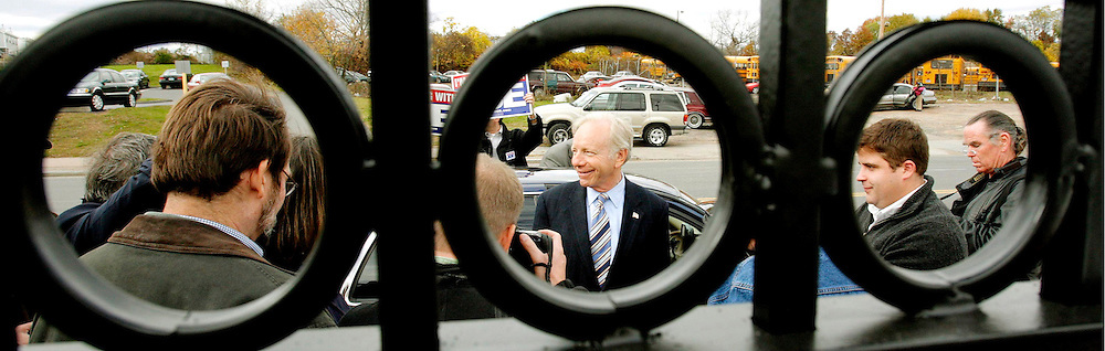 epa00849374 Senator Joe Lieberman (C), D-CT, talks with the press after a campaign event with Senator Mary Landrieu, D-LA, at the Ragun Cajun restaurant in Hartford, Conneticut on Thursday 26 October 2006. Lieberman is running for re-election as one of Connecticut's senators as an independent after losing in the primary to opponent Dan Lamont.  EPA/JUSTIN LANE