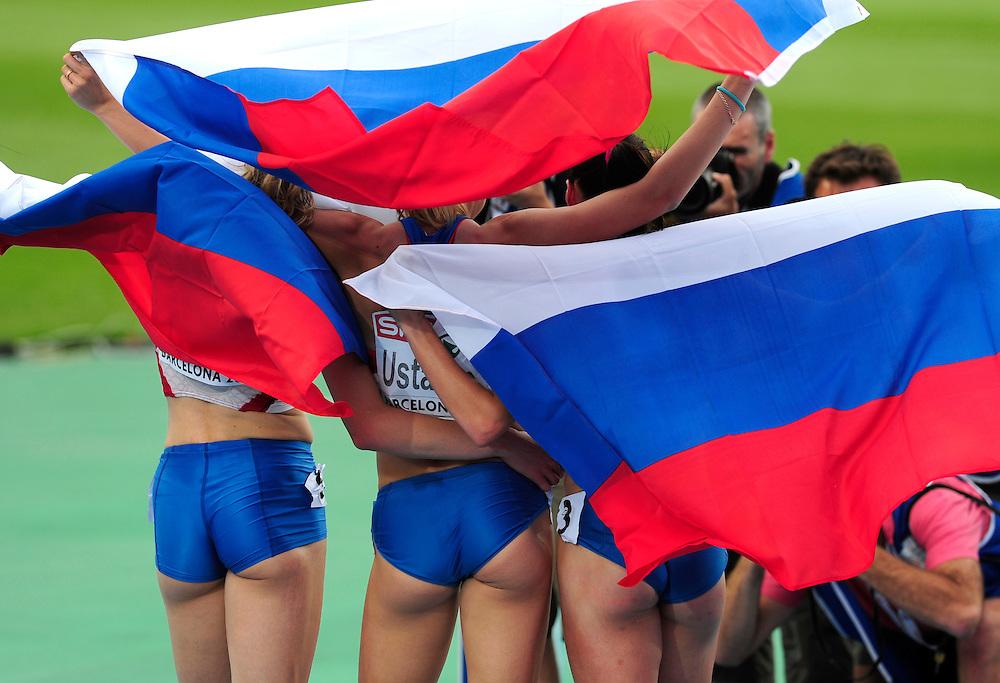 Russia's Tatyana Firova, Kseniya Ustalova and Antonina Krivoshapka pose for photographers after winning the first three places in the women's 400m final at the 2010 European Athletics Championships at the Olympic Stadium in Barcelona.