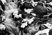 Water flows through an icy Falls Creek.