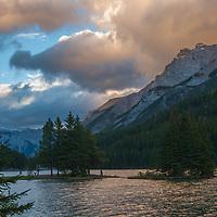 A sunset illuminates Two Jack Lake.