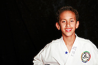 7 February 2008: 12 year old Shane Fisser. Tae Kwon Do student athletes in motion. Young kids practicing Taekwondo at the USA Black Belt Academy in Huntington  Beach, CA. Tae Kwon Do is a Korean Martial Art discipline that trains the body and mind.  It is global sport that is an official Olympic sport. ? Background Retouched *