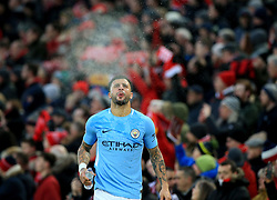 Manchester City's Kyle Walker sprays water from his mouth before the Premier League match at Anfield, Liverpool.