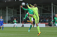 Luka Kacavenda of Bosnia and Herzegovina (1) beats Adam Idah of Republic of Ireland (9) to the ball during the UEFA European Under 17 Championship 2018 match between Bosnia and Republic of Ireland at Stadion Bilino Polje, Zenica, Bosnia and Herzegovina on 11 May 2018. Picture by Mick Haynes.