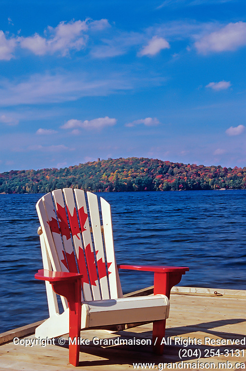 Muskoka chair on Lake of Bays,relaxing<br />Dorset<br />Ontario<br />Canada