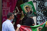 On the day that covid pandemic guidelines for shoppers in England mean that the wearing of face coverings in shops is mandatory, protesters carry placards with the face of Syed Farrakh Hussain Shah, on 24th July 2020, in London, England. Pakistani national Syed Farrakh Hussain Shah has been missing since 5th October 2019 in the Afghan capital, Kabul while heading to Hamid Karzai international airport.