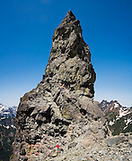 Climber Brian Polagye sits at the base of East Wilmans Spire, Mount Baker-Snoqualmie National Forest, Washington.
