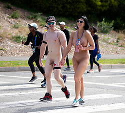 A naked couple walks through Golden Gate Park at the 107th running of the Bay to Breakers, Sunday, May 20, 2018, in San Francisco. (Photo by D. Ross Cameron)