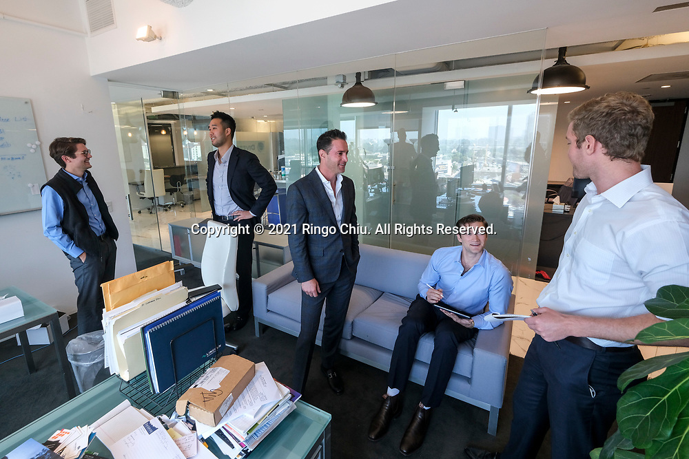 Kevin Ma, second from left, and Ron Naylor, center, co-founders and managing partners of Diversis Capital Management. (Photo by Ringo Chiu)