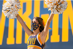 Oct 3, 2020; Morgantown, West Virginia, USA; A West Virginia Mountaineers cheerleader performs during the third quarter against the Baylor Bears at Mountaineer Field at Milan Puskar Stadium. Mandatory Credit: Ben Queen-USA TODAY Sports