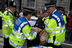 UK, LONDON 5th August 2006.. Thousands of people joined a street protest agaist Israel war on Lebanon & Palestine, calling for an immediate ceasefire and to end Blair's support for Bush's wars.The organizers claim that aroung 100,000 protesters have marched from Hyde Park to Parliament Square. The initial Police figure is around 20,000. .The Demo has been called by Stop the War Coalition, CND, Palestine Solidarity Campaign, British Muslim Initiative and Lebanese Community Organisations.