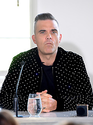 Robbie Williams attending the X Factor photocall held at Somerset House, London.