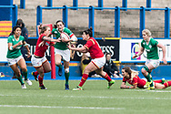 Hannah Tyrrell of Ireland breaks free from the tackles of Adi Taviner (r) and Rebecca de Filippo (l) of Wales.<br /> RBS Womens Six Nations 2017 international rugby, Wales women v Ireland women at the BT Sport Cardiff Arms Park in Cardiff , South Wales on Saturday 11th March 2017.  pic by Simon Latham, Andrew Orchard sports photography