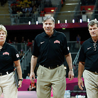 05 August 2012: USA Assistant Coaches Jennifer Gillom and Richard Bruno, are seen going back to the locker room at halftime next to USA head coach Geno Auriemma during 114-66 Team USA victory over Team China, during the women's basketball preliminary, at the Basketball Arena, in London, Great Britain.