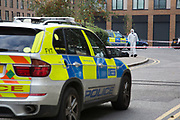 Forensics team at the crime scene where a male police officer was shot during a firearms operation in Scriven Street in the Haggerston area of Hackney. A specialist firearms unit and officers from Trident Area Crime Command, which is responsible for tackling gang crime, were conducting an operation in Scriven Street at the time of the shooting.