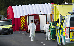© London News Pictures. 11/09/2012. Hindhead, UK . Forensics and ambulance workers at the scene of a fatal bus crash on the north bound A3 motorway near Hindhead Tunnel, Hindhead, Surrey on September 11, 2012.Three people were killed and a number of others seriously injured when a coach carrying overturned after crashing into a tree. Photo credit: Ben Cawthra/LNP