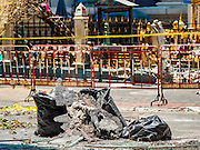 18 AUGUST 2015 - BANGKOK, THAILAND: Part of the pavement melted in the fire that followed an explosion at Erawan Shrine in Bangkok. An explosion at Erawan Shrine, a popular tourist attraction and important religious shrine in the heart of the Bangkok shopping district, killed at least 20 people and injured more than 120 others, including foreign tourists, during the Monday evening rush hour. Twelve of the dead were killed at the scene. Thai police said an Improvised Explosive Device (IED) was detonated at 18.55. Police said the bomb was made of more than six pounds of explosives stuffed in a pipe and wrapped with white cloth. Its destructive radius was estimated at 100 meters.    PHOTO BY JACK KURTZ