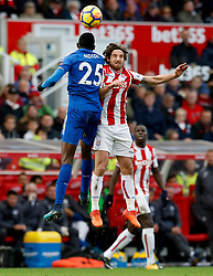 Leicester City's Wilfred Ndidi (left) and Stoke City's Joe Allen (right) battle for the ball