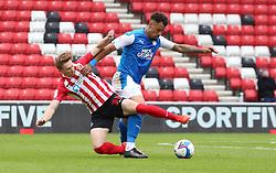 Jonson Clarke-Harris of Peterborough United in action with Denver Hume of Sunderland - Mandatory by-line: Joe Dent/JMP - 26/09/2020 - FOOTBALL - Stadium of Light - Sunderland, England - Sunderland v Peterborough United - Sky Bet League One