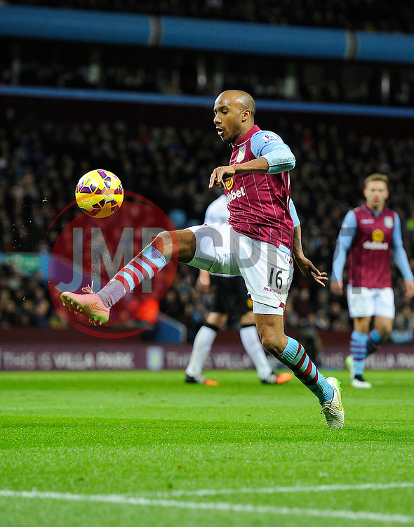Aston Villa's Ciaran Clark clears the ball  - Photo mandatory by-line: Joe Meredith/JMP - Mobile: 07966 386802 - 20/12/2014 - SPORT - football - Birmingham - Villa Park - Aston Villa v Manchester United - Barclays Premier League