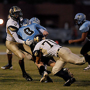 South Brunswick High School's A.J. Price is tackled by North Brunswick High School's Brandon Addison, left, and Josh McCauley Friday September 13, 2013 at Sough Brunswick High School. (Jason A. Frizzelle)