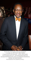 ALVIN HALL the money writer at a reception in London on 18th March 2003.PIC 58