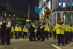© Licensed to London News Pictures.  27/08/2021. London, UK. Members of Extinction Rebellion are seen blocking the Queen Victoria Street and Cannon Street in central London. They are protesting against the use of Fossil fuels. Photo credit: Marcin Nowak/LNP