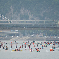 Participants paddle on their SUPs during the Budapest SUP Festival on river Danube in downtown Budapest, Hungary on July 17, 2021. ATTILA VOLGYI