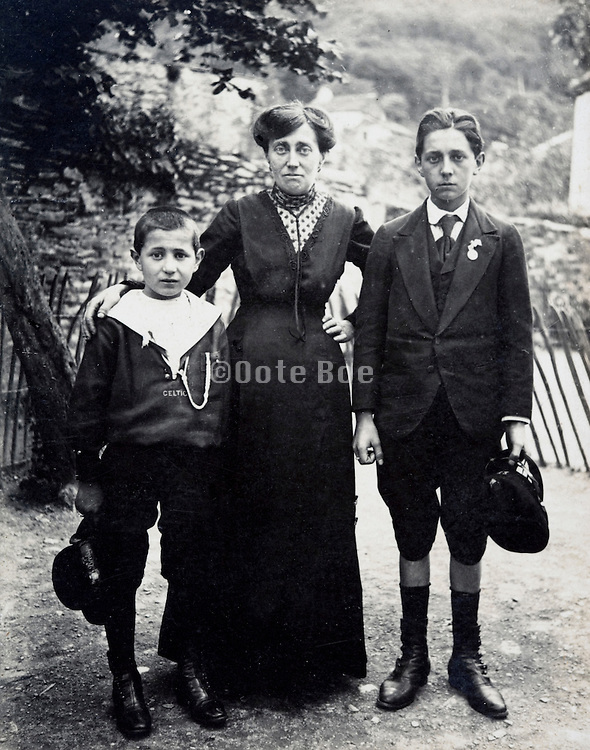 grandmother with her two grand children posing for a photo