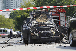 June 27, 2017 - Kiev, Ukraine - A man looks at the wreckage of a car in Kiev, Ukraine, on June 27, 2017. Ukrainian media reported that a senior military intelligence officer has been killed in a car bomb in Ukrainian capital. (Credit Image: © Serg Glovny via ZUMA Wire)