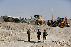 August 14, 2017 - Hebron, West Bank, Palestinian Territory - Israeli troops and bulldozers are seen as they demolish a house in the Palestinian bedouin village of Khashm al-Daraj in the southern area of Yatta, south of the West Bank city of Hebron (Credit Image: © Wisam Hashlamoun/APA Images via ZUMA Wire)
