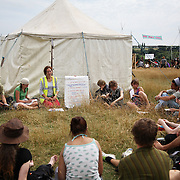 Climate Camp by Kingsnorth 2008.Camp for Climate Action is a movement made up of a lose network of people and environmental groups, wanting to stop climate change.  Through the Climate Camp they highlight issues such as aviation emission and CO2 emissions from coal power plants.  The Camp for Climate Camp wants to create a forum for people to discuss, learn and to act on climate change and to put pressure on the UK government to change its policies on polloting industries to make them commit to much more green policies. .The Climate Camp at Kingsnorth is the third camp running, previous years were by Heathrow, London and Drax coal power plant in Yorkshire. ...A work shop for Legal Observers.  Legal Observers are trying to keep an eye on the police and make sure no laws are broken, and will be taking notes of who gets arresteed and what for, and who gets hurt by police and make sure all is noted down.  To be Legal Observer takes training which provides basic knowledge of the law.