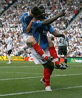 Photo: Steve Bond. <br />Derby County v Portsmouth. Barclays Premiership. 11/08/2007. Benjani Mwaruwari celebrates with David Nugent on board