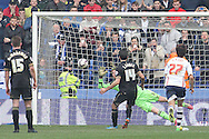 Bolton Wanderer's goalkeeper saves the penalty attempt of Wigan Athletic's Jordi Gomez. Skybet football league championship match , Bolton Wanderers v Wigan Athletic at the Reebok stadium in Bolton on Saturday 29th March 2014.<br /> pic by David Richards, Andrew Orchard sports photography.