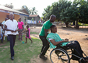 Leader of the Conventions Peoples' Party Ivor Greenstreet and Youth Organizer James Kwabena Bomfeh leave after their visit of a gathering of people with disabilities at Agomeda, Ghana. Saturday, June 4, 2016. Photo: Francis Kokoroko