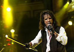 """© Licensed to London News Pictures. 16/09/2012. London, UK.  Alice Cooper performs at The Sunflower Jam at the Royal Albert Hall.  The Sunflower Jam is a British charity, founded by Jacky Paice, wife of Deep Purple drummer, Ian Paice. Other high-profile supporters are the actor Jeremy Irons, ex-Jamiroquai bassist Nick Fyffe and Charles, Prince of Wales. The aims of the charity are to fund complementary therapists and spiritual healers to work on cancer wards in the British National Health Service. After setting up a meeting between members of Deep Purple and a young boy dying of leukemia, Paice saw """"all the good work the healers were doing"""" and decided """"lets find a way to raise money to get more healers in there. Photo credit : Richard Isaac/LNP"""