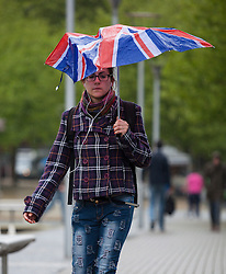 © Licensed to London News Pictures. 14/05/2015. Bristol, UK. A woman with a union jack umbrella braving the wet weather in Bristol city centre today, Thursday 14th May 2015. Photo credit : Rob Arnold/LNP