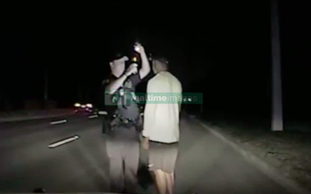 "A barefoot Tiger Woods is seen here disorientated and struggling to walk in dramatic dash cam footage taken at the scene of his DUI arrest in Florida. Video released by cops today (May 31) shows the pro golfer undertaking a series of sobriety tests, which he ultimately failed. In the 98-minutes of footage released by Jupiter Police, the 41-year-old father-of-two — who underwent a procedure on his back in April — is seen swaying, rolling his eyes, slurring his words and falling asleep during the a series of sobriety tests. After failing the field tests, Woods is formally arrested and cuffed with his hands behind his back. According to the police report, Woods was found asleep at the wheel of his 2015 Mercedes Benz and was on four prescription drugs when he was arrested on suspicion of driving under the influence in the early hours of May 29 in Jupiter, Florida. He tested negative for alcohol. Elsewhere in the report it notes that Woods had 'extremely slow and slurred speech' and did not know where he was before taking the field tests. The golfer undertook four sobriety tests. After being asked to recite the alphabet backwards, he instead offered to recite the National Anthem backwards instead. During the Walk & Turn test the sportsman ""could not maintain starting position… missed heel to toe each time… stepped off the line several times… used arms for balance,"" according to the arresting officer's report. He was also unable to perform the One Leg Stand, requiring him to lift one leg off the ground six inches, placing his foot down ""several times"" while trying to complete the task. Woods was also seemingly confused by the Finger To Nose test, and was unable to complete the task as asked, the report notes. The car Woods was driving was found with two flat tires and ""fresh damage"" to the driver's side, the report notes, and police released images of the bashed up car on May 31. Woods released a statement on May 29 in which he apologized for t"