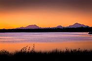 Mt. McKinley, Mt. Hunter, and Mt Foraker from Kashwitna Lake at sunset, Interior Alaska, summer.