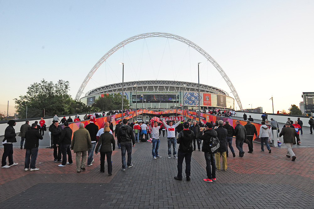 England and Poland fans arrive at Wembley Stadium ahead of the World Cup Qualifying match<br /> <br /> Photo by Chris Vaughan/CameraSport<br /> <br /> International Football 2014 World Cup Euro Qualifying Group H - England v Poland - Tuesday 15th October 2013 - Wembley Stadium - London<br /> <br /> © CameraSport - 43 Linden Ave. Countesthorpe. Leicester. England. LE8 5PG - Tel: +44 (0) 116 277 4147 - admin@camerasport.com - www.camerasport.com