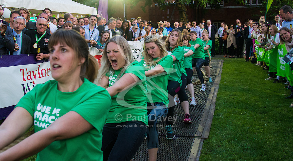 Westminster, London, June 6th 2016.The McMillans women's team pull against the team of female MPs as teams from uk industry as well as the House of Commons and the House of Lords compete in the annual McMillan Cancer Charity tug o' war.