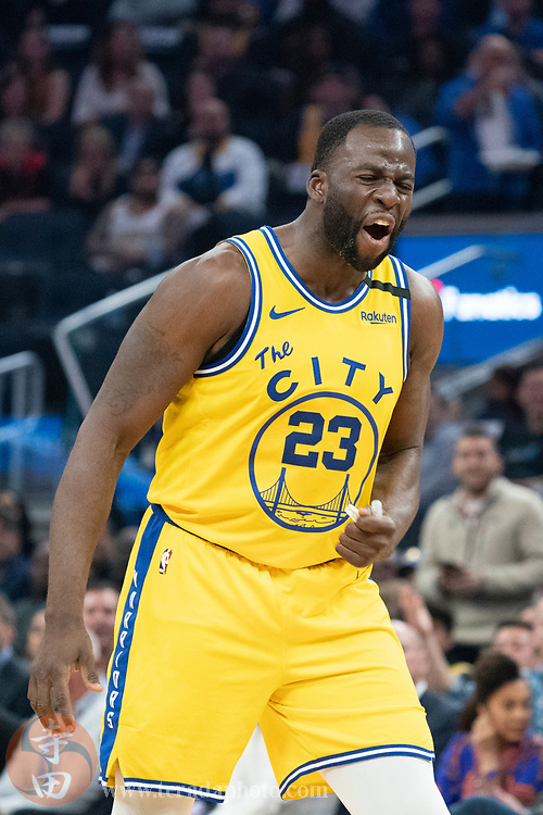 February 27, 2020; San Francisco, California, USA; Golden State Warriors forward Draymond Green (23) reacts after being ejected during the second quarter against the Los Angeles Lakers at Chase Center.