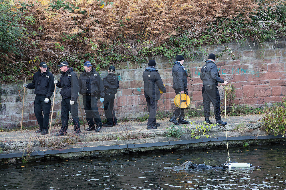 © Licensed to London News Pictures . 16/11/2015 . Liverpool , UK . Underwater and land search teams at the Leeds-Liverpool Canal in the Eldonian Village area of Liverpool where a 16 year old boy was shot dead last night (15th November 2015 ) . Photo credit: Joel Goodman/LNP