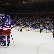 Ryan McDonagh, New York Rangers is congratulated by team mates after scoring his side second goal during the New York Rangers Vs Philadelphia Flyers, NHL regular season game at Madison Square Garden, New York, USA. 26th March 2014. Photo Tim Clayton